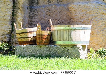 Wooden Buckets And Tubs In The Courtyard Of Fortresses Guaita On Mount Titan. The Republic Of San Ma