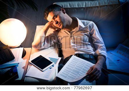 Overworked Businessman On Sofa