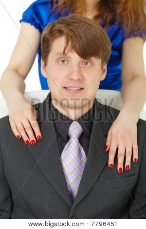 Female Hands On Shoulders Of Men