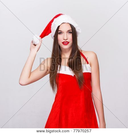 Young Woman In Santa Outfit Pulling Pompon