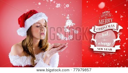 sexy santa girl blowing over hands against red vignette