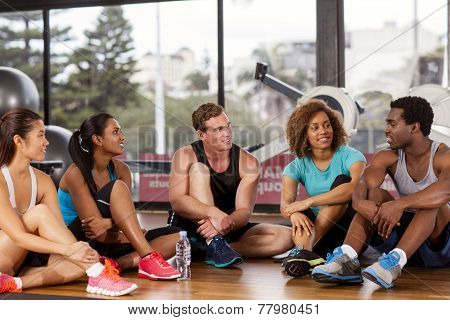 Group Relaxing Before A Gym Class