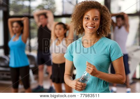 Young Mixed-race Woman In A Gym