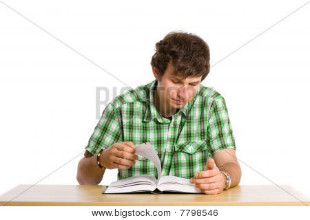 Young Adult Student Look Through The Book, Isolated