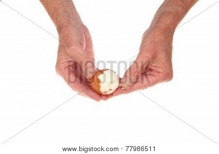 Hands Peeling Egg