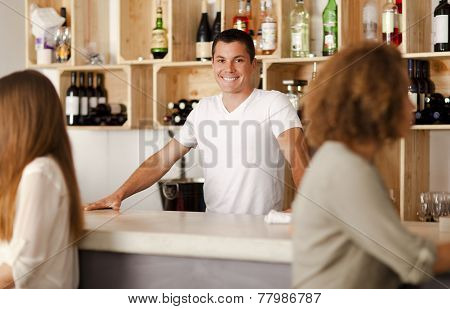 Happy Young Barman In A Bar