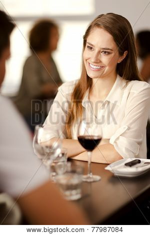 Beautiful Young Woman In A Restaurant.