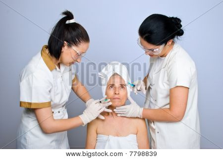 Doctors Injecting To Senior Woman