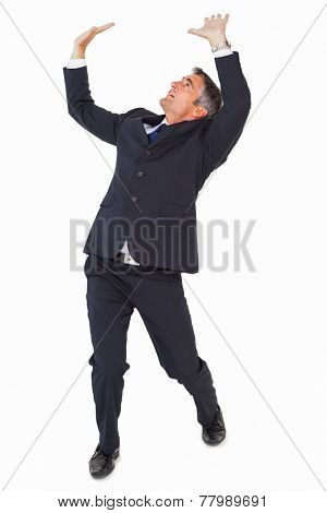 Businessman well dressed looking up and pushing on white background