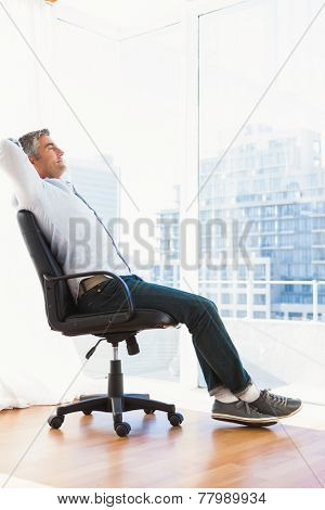 Man sitting on his office chair resting at apartment
