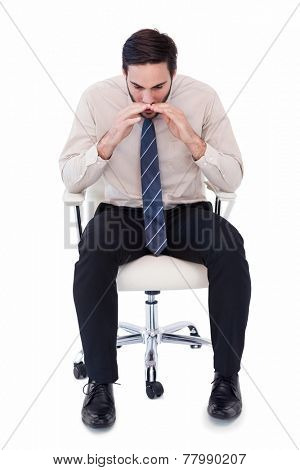 Businessman sitting on swivel chair shouting on white background