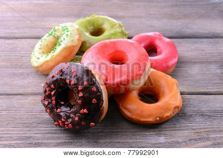 Delicious donuts with glaze on table close-up