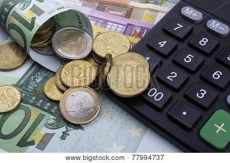 Euros (eur) And A Calculator. Business Concept.