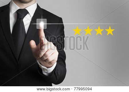 Businessman Pushing Button Four Stars Advertisement