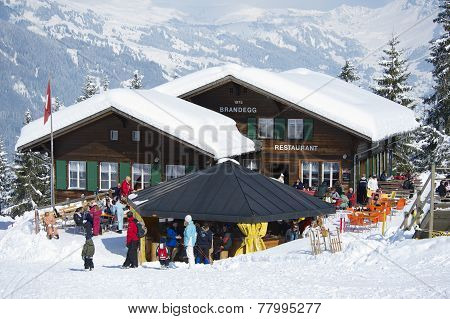 Unidentified tourists relax at the Brandegg ski station, Grindelwald, Switzerland.