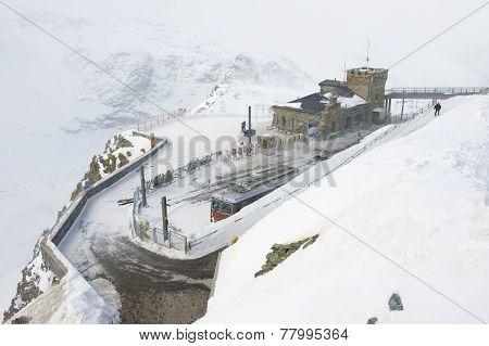 Tourists present at snow storm at the Gornergratbahn upper station, Zermatt, Switzerland.