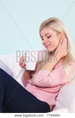 Woman Sat With A Mug Of Tea