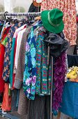 stock photo of thrift store  - sell of clothes in a street market - JPG