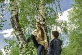 stock photo of full cheeks  - Portrait of a girl and a boy on a background of a full-blown birch. ** Note: Visible grain at 100%, best at smaller sizes - JPG