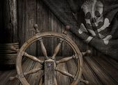 stock photo of steers  - Pirates ship steering wheel with old jolly roger flag - JPG