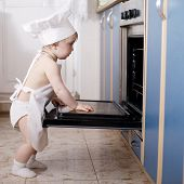 stock photo of oven  - little chef cooks in the oven food - JPG