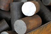 picture of raw materials  - Round billet of metal raw materials for further processing - JPG