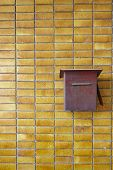 picture of postbox  - Yellow Tiles Wall With Red Rusty Postbox Home decoration - JPG