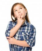 stock photo of daydreaming  - Little girl is daydreaming - JPG