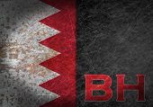 picture of bahrain  - Old rusty metal sign with a flag and country abbreviation  - JPG