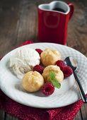 stock photo of cream puff  - Dessert With Vanilla Ice Cream And Puff Pastry Filled With Dairy Cream - JPG