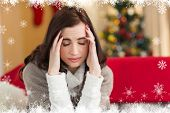 pic of pain-tree  - Brunette getting a headache on christmas day against fir tree forest and snowflakes - JPG