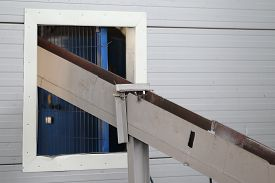 stock photo of chute  - chute for rolling grinding balls in a container - JPG