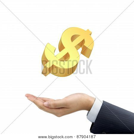 Businessman's Hand Holding A Golden Money Symbol
