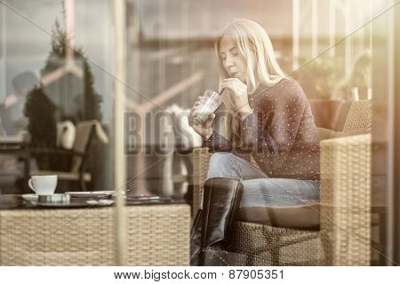 Happiness female with coffee. View through glass.
