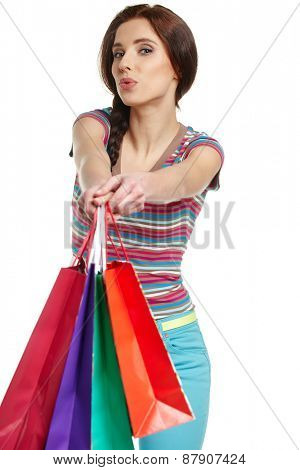lovely woman with shopping bags over white