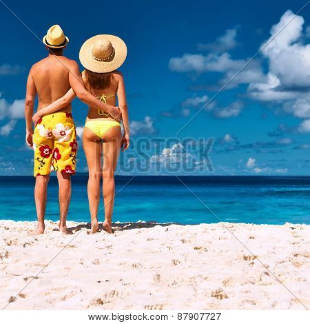 Couple on a tropical beach at Seychelles, La Digue