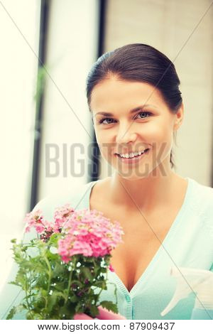 bright picture of lovely housewife with flower