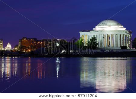 Thomas Jefferson Memorial at dawn during cherry blossom festival.