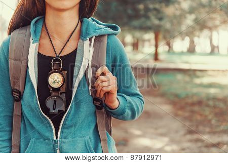 Tourist Girl With A Compass
