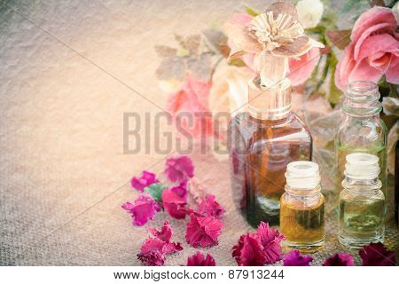 Bottles with basics oils for spa on mulberry paper texture vintage style
