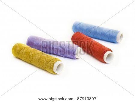 thread reels on white
