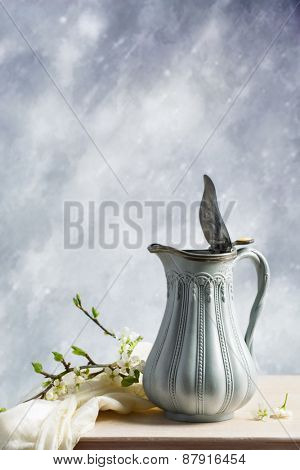 Antique jug with sprig of spring blossom