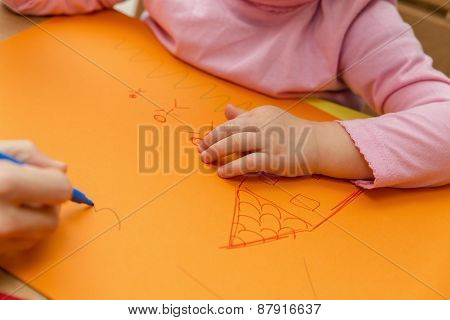 Mother And Child Are Painting A Picture Together