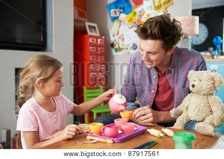 Father Playing Game With Daughter And Toys In Bedroom