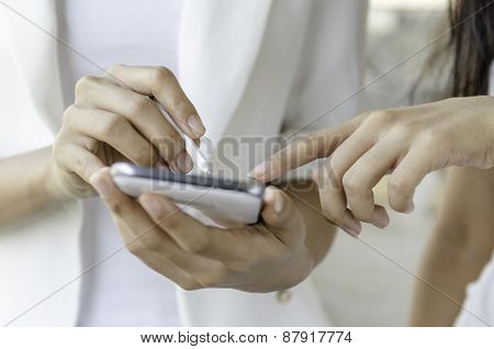 women using tablet with stylus pen