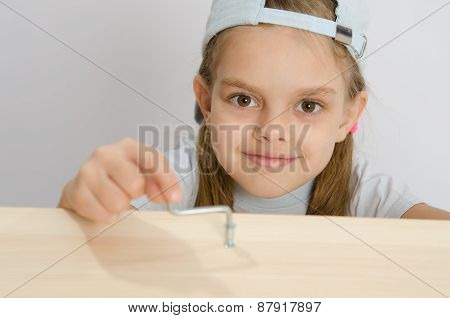 Girl Twists The Screw With An Allen Key