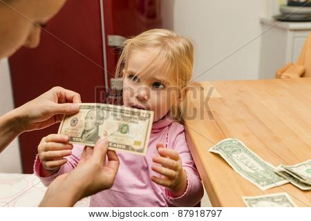 Little Girl Gets Ten Dollars From Her Mother
