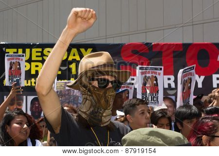 Man Wearing Face Mask Raising Hand For Justice