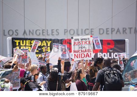 People With Raised Signs In Front Of Los Angeles Police Department