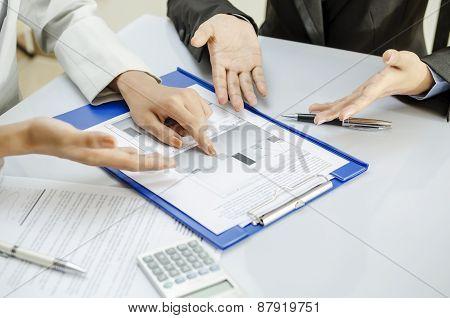 Team working on printout